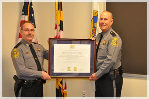 Major James Williams and I displaying the CALEA full accreditation, saving county tax dollars by being in compliance with local and state standards. Few agencies have earned this excellence standard.
